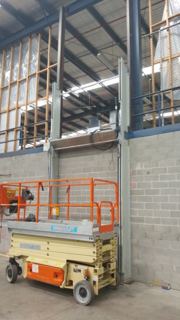 First Install of hoist attaching to structural steel beams